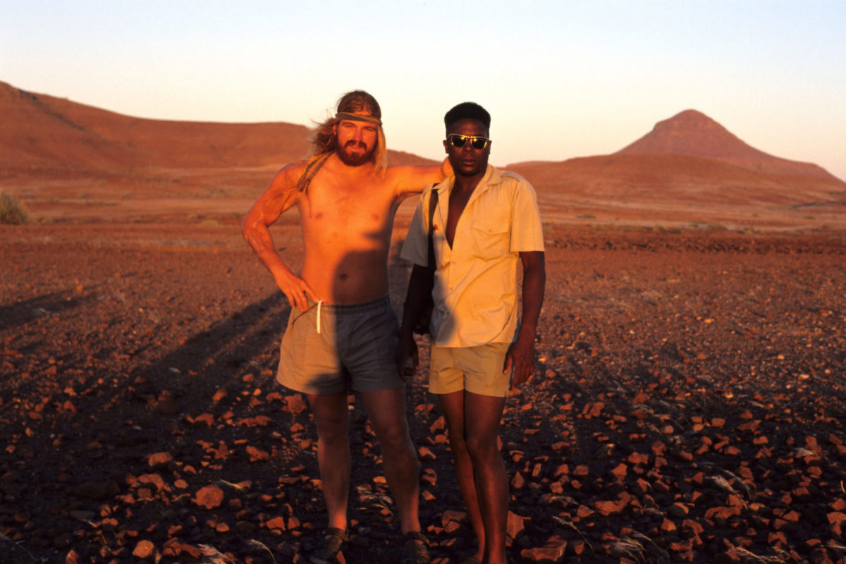 """Chris Bakkes and Vitalus Florry - the best trackers in Damaraland (1998). Vitalus was known for his ability to identify """"his"""" individual rhinos based on their tracks in this rocky terrain."""