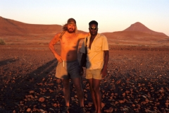 "Chris Bakkes and Vitalus Florry - the best trackers in Damaraland (1998). Vitalus was known for his ability to identify ""his"" individual rhinos based on their tracks in this rocky terrain."