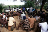 A big Himba meeting with John Kasaona standing in the center and Garth Owen-Smith sitting to the left side (2000).