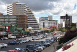 View on Independence Avenue in the year 2008. This parking place does not exist anymore and new buildings have taken over the place.