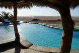 At the pool of the Rostock Ritz Desert Lodge you can perfectly relax with a wonderful view.